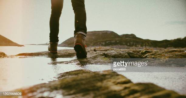 man mountain hiking in the nature of norway - bergen norway stock pictures, royalty-free photos & images