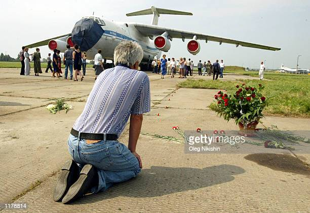 A man mourns at the SU27 crash site July 29 2002 in Lviv Ukraine Residents in this western Ukrainian city continue two days of official mourning...