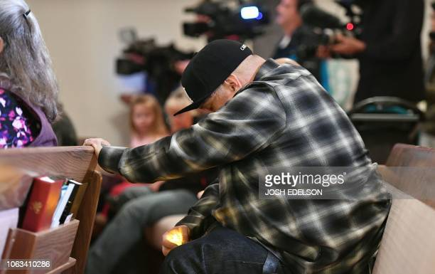 A man mourns during a vigil for victims of the Camp fire at First Christian Church in Chico California on November 18 2018