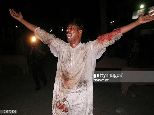 A man mourns following explosions during a Shiite Muslim procession on September 1 2010 in Lahore Pakistan Current reports suggest that three...