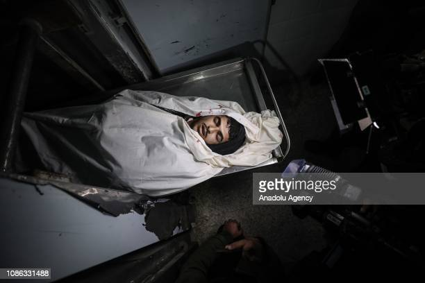 A man mourns for Mahmoud Abed alNabahin who was killed by Israeli army at Al Aqsa hospital in Deir Al Balah Gaza on January 22 2019