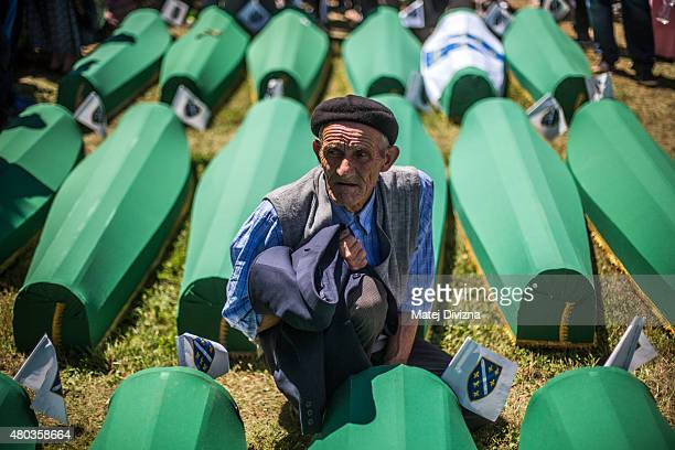 A man mourns over the coffin before the mass funeral for 136 newlyidentified victims of the 1995 Srebrenica massacre attended by tens of thousands of...