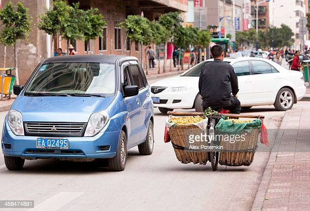 man move fruits on bicycle - alex potemkin or krakozawr stock pictures, royalty-free photos & images