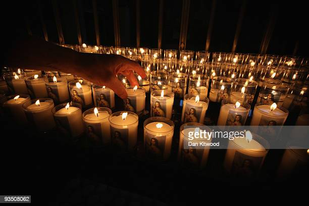A man moves a candle inside Westminster Cathedral on November 30 2009 in London United Kingdom The English Heritage Cathedrals Fabric Condition...