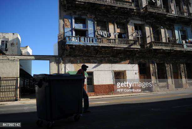 TOPSHOT A man moves a waste container in Havana on September 15 2017 Hit harder than expected by Hurricane Irma Cuba faces months of difficult...