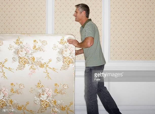 Man Moving a Mattress