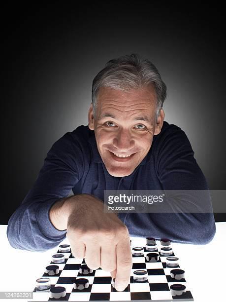 Man moving checker piece