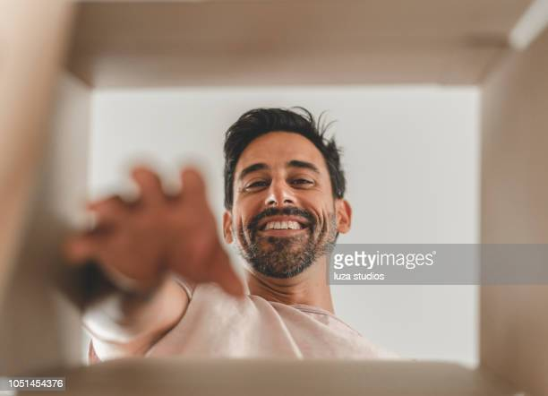 man moving into a new house - help:contents stock pictures, royalty-free photos & images