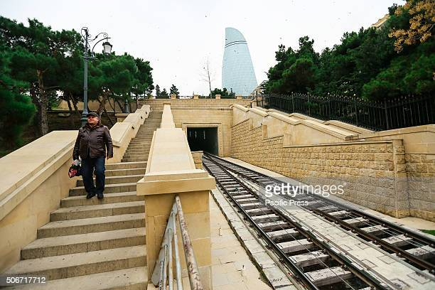 A man moving near the funicular railway on the park