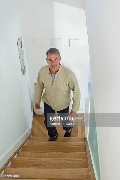 Man moving up on a staircase