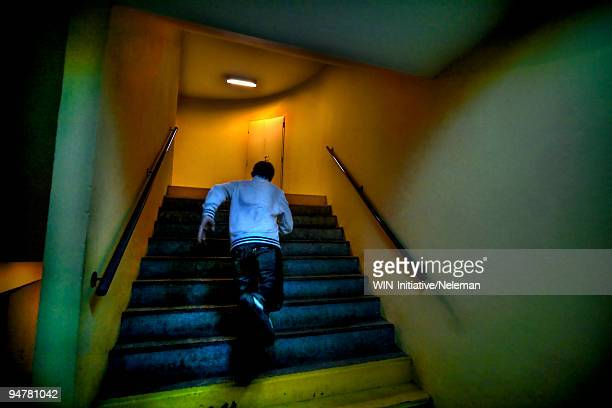 man moving up stairs, argentina - 逃げる ストックフォトと画像