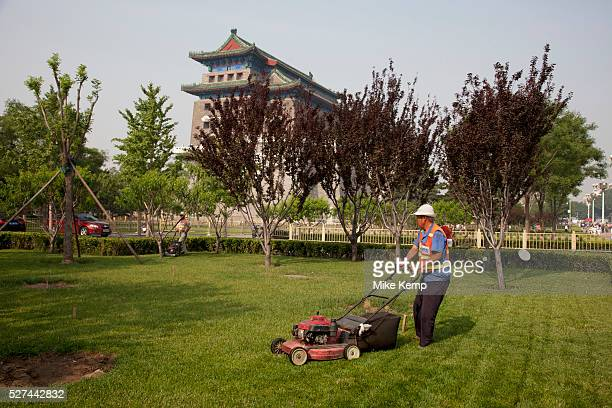 Man mowing the grass at Qianmen is a gate in Beijing's historic city wall The gate is situated to the south of Tiananmen Square and once guarded the...