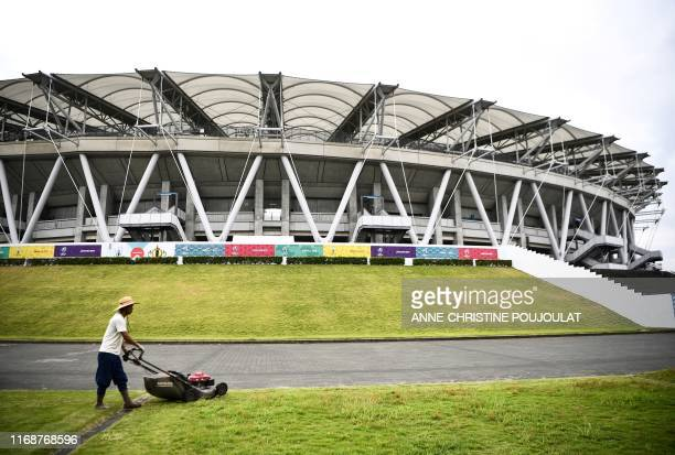 A man mows the lawn in front of the Ecopa Stadium in Shizuoka on September 17 ahead of the Japan 2019 Rugby World Cup
