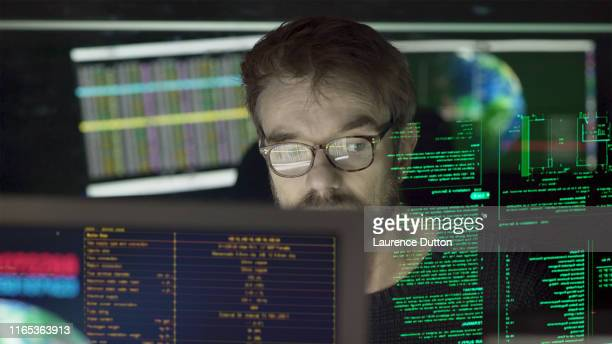 man multi monitors - surveillance stock pictures, royalty-free photos & images