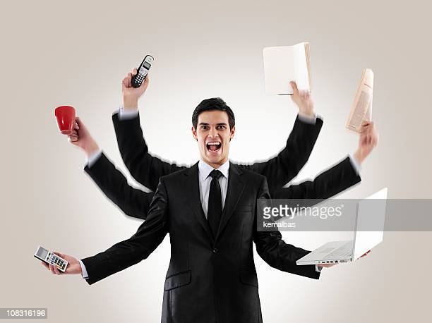 a man multitasking with several arms holding items - multi tasking stock pictures, royalty-free photos & images