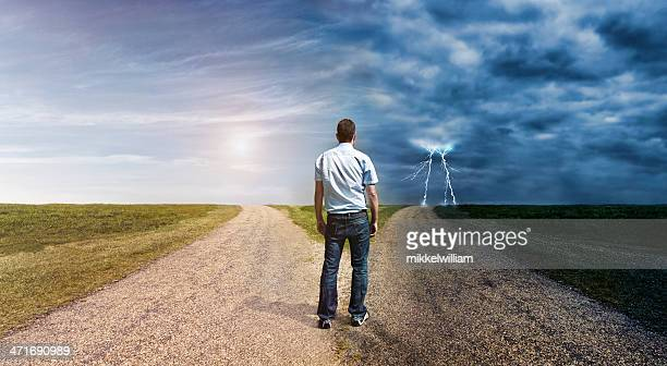 man must decide his way forward to success or failure - fork stock pictures, royalty-free photos & images