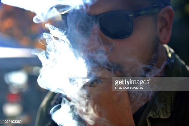 A man named Fred smokes marijuana in a pipe in Vancouver Canada on October 2018 Nearly a century of marijuana prohibition came to an end Wednesday as...