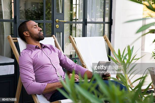 Man napping in deckchair