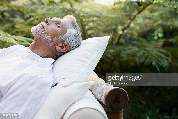 man napping - prosperity stock pictures, royalty-free photos & images