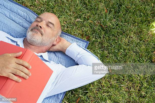 Man napping with a book on his chest