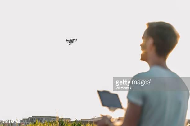 Man navigating drone