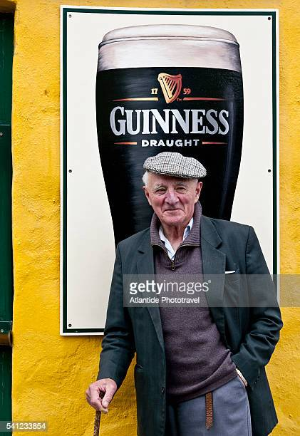 man near a pub - guinness stock pictures, royalty-free photos & images