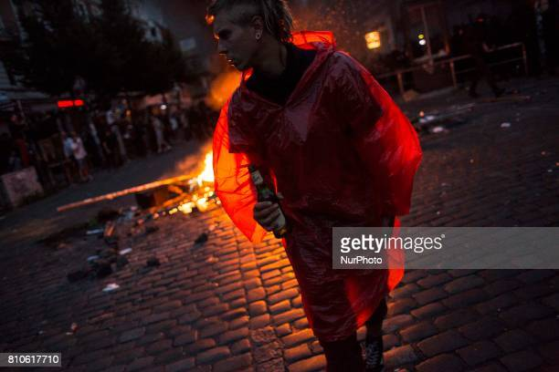 Man near barricade during riots in St Pauli district during G 20 summit in Hamburg on July 8 2017 Authorities are braced for largescale and...