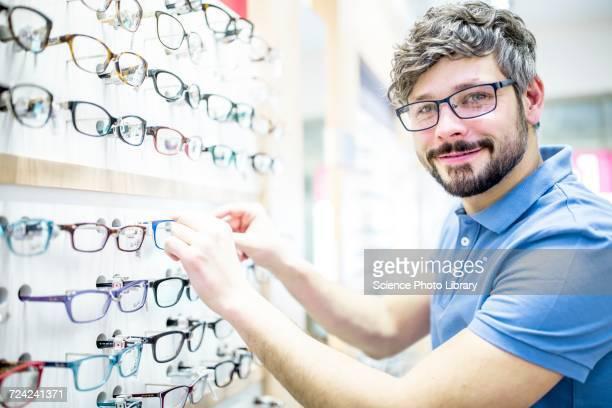Man near glasses rack