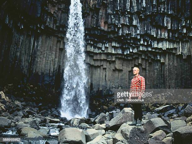Man near the waterfall in Iceland