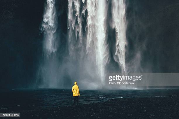 man near the waterfall - waterfall stock pictures, royalty-free photos & images