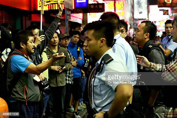 Man negotiates with police after he allegedly shone an infra-red light from his camera at a police constable on a street in Mongkok on November 27,...