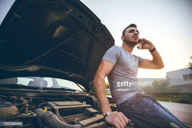 man next to a broken down car - next to stock pictures, royalty-free photos & images