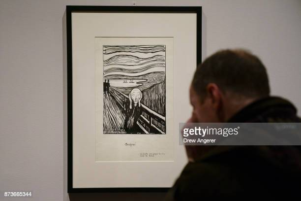 A man observes a lithographic crayon version of 'The Scream' during a preview of the Edward Munch exhibition titled 'Between The Clock and The Bed'...