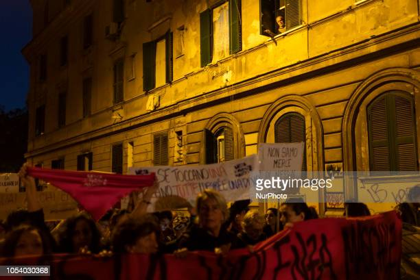 Man observes a march organised by 'Non Una Di Meno' movement in San Lorenzo neighbourhood of Rome, Italy, on October 26 a week after a female...
