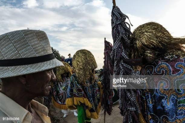 A man observes a quotCaboclo de Lançaquot during a presentation of Maracatu in the city of Nazaré da Mata in Northeast Brazil on January 13 2018