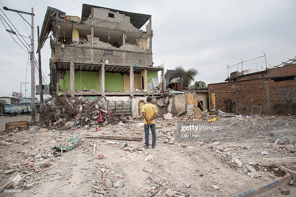 A man observes the aftermaths of an earthquake struck Ecuador on April 21, 2016 in Pedernales, Ecuador. At least 400 people were killed after a 7.8-magnitude quake and the government's food supply is not reaching everyone.