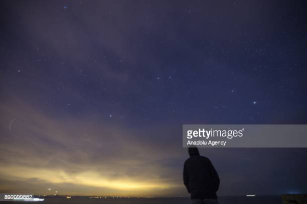Man observes the night sky during the Geminid meteor shower over Kerpe neighbourhood in Kandira district of Kocaeli, Turkey on December 14, 2017....