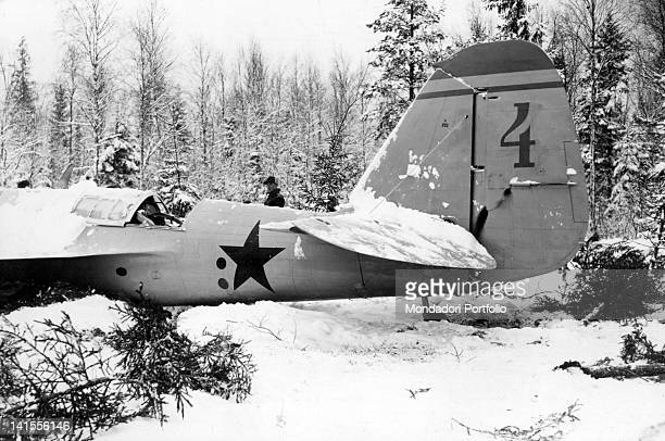 A man observing a Soviet fighter shot down on Christmas Eve in the vicinity of Helsinki Finland December 1939