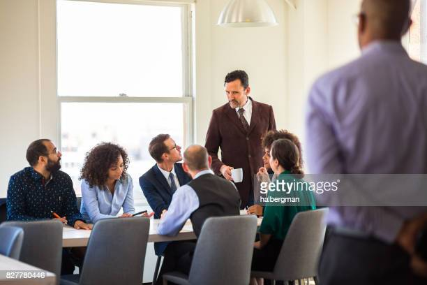 Man Observing Colleagues in Business Meeting at Startup
