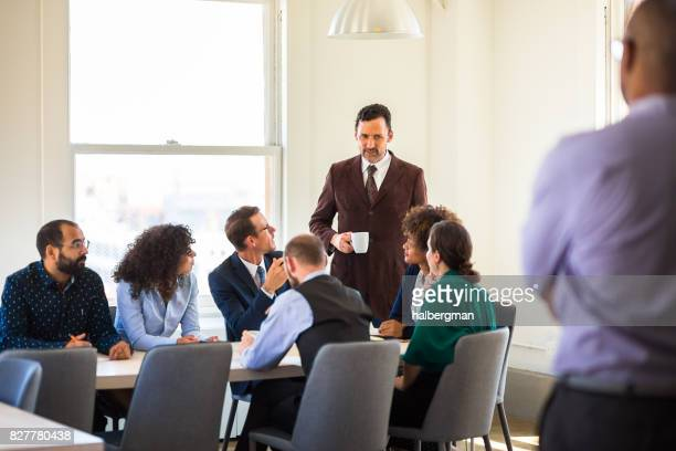 Man Observing Colleagues in Business Meeting