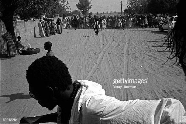 Man of Baye Fall practices traditional rituals in Mbake during the Magal De Touba April 23 2003 in Mbake Senegal The Mouride Baye Fall community in...