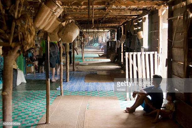 Man of Iban tribe sitting in Longhouse.