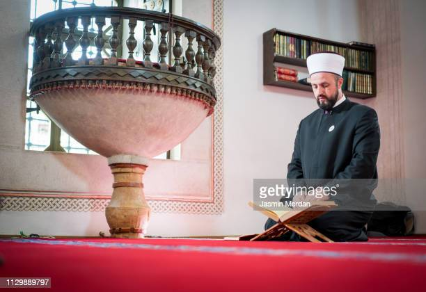Man of islam sitting in mosque reading