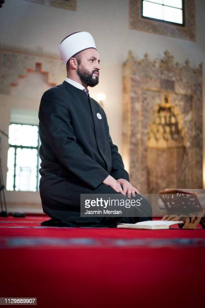 man of islam sitting in mosque reading - isfahan imam stock pictures, royalty-free photos & images