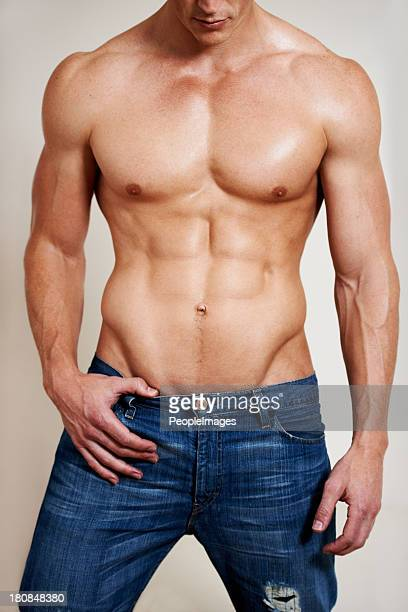 man of muscle - male torso stock photos and pictures