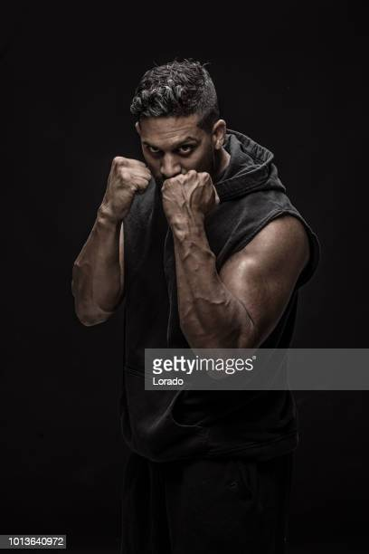 man of non caucasian indian descent in mma boxing stance in studio shot - combat sport stock pictures, royalty-free photos & images
