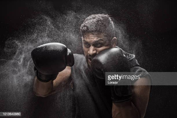 man of non caucasian indian descent in mma boxing stance in studio shot - boxing stock pictures, royalty-free photos & images