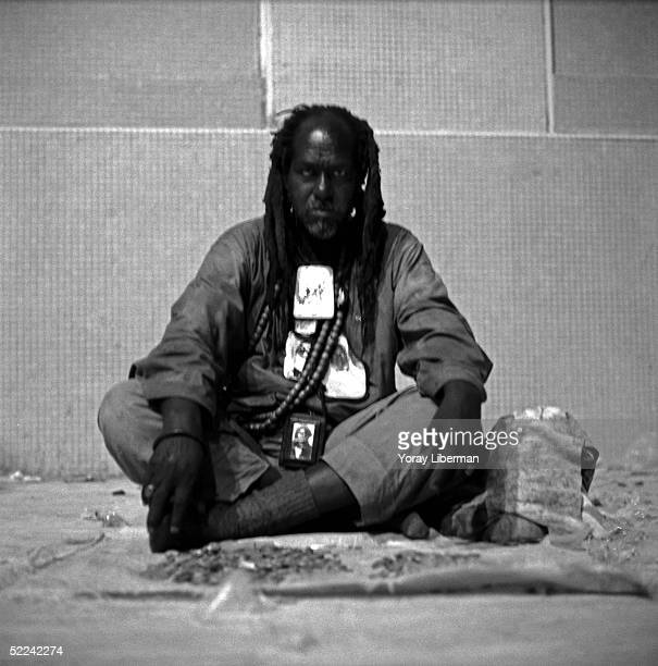 A man of Old Baye Fall sits near the mosque of Touba during the Magal De Touba April 21 2003 in Touba Senegal The Mouride Baye Fall community in...