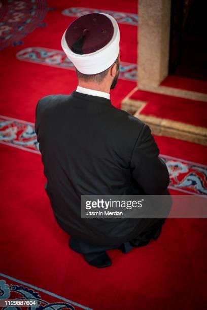 man of religion inside mosque praying - イマーム寺院 ストックフォトと画像
