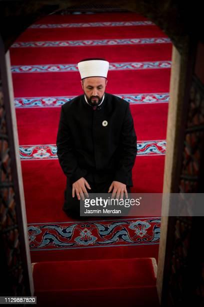 Man of religion inside mosque praying